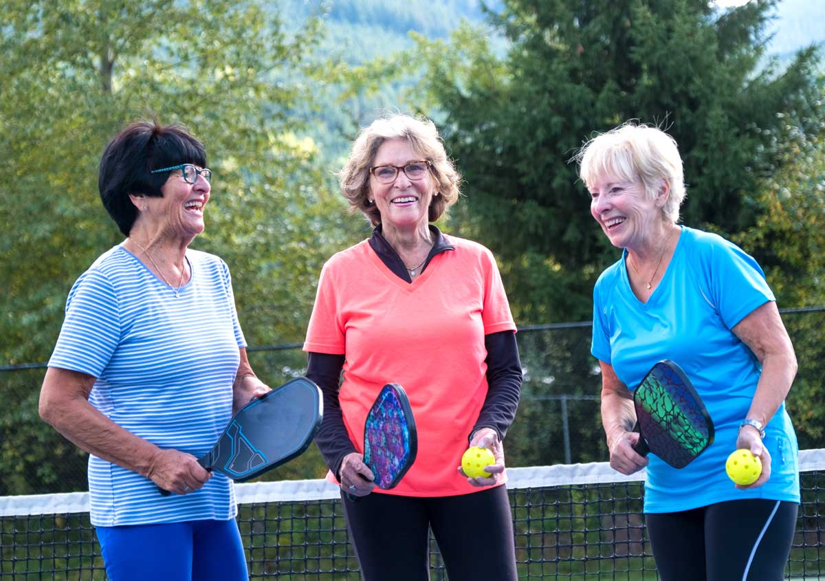 Women playing pickleball